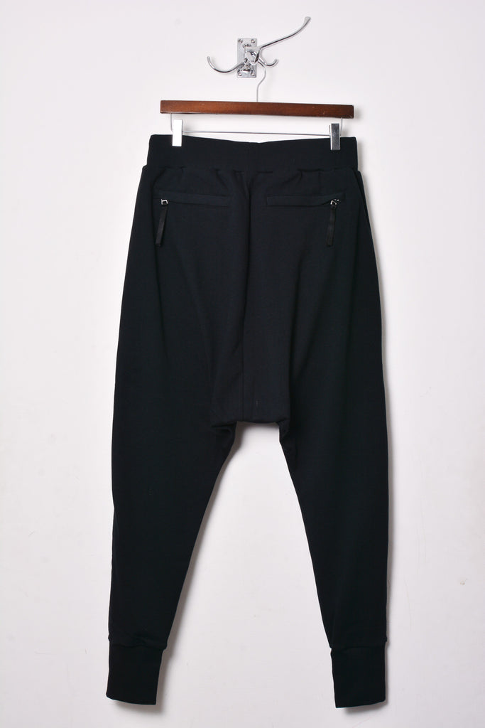 UNCONDITIONAL Black drop crotch full length trousers with long front zip detailing