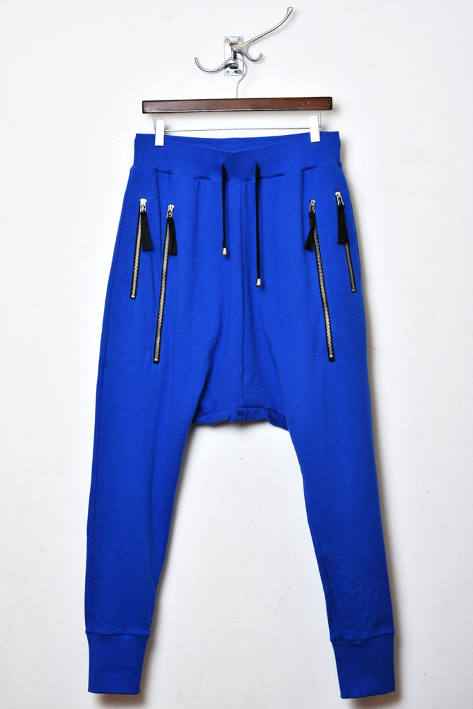 UNCONDITIONAL Lapis drop crotch trousers with double long zip pocket.