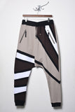 UNCONDITIONAL tribal stripe drop crotch trouser in linen with bitter chocolate, black, white stripes