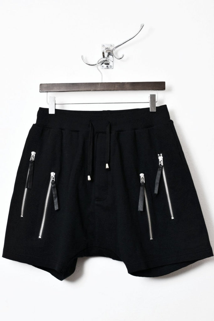 UNCONDITIONAL black with double silver zip low rise drop crotch shorts.