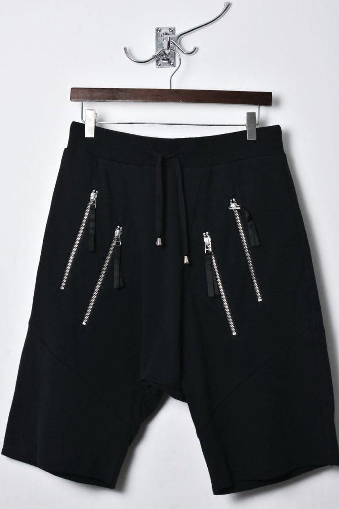 UNCONDITIONAL black with double zip up pockets low rise drop crotch shorts.