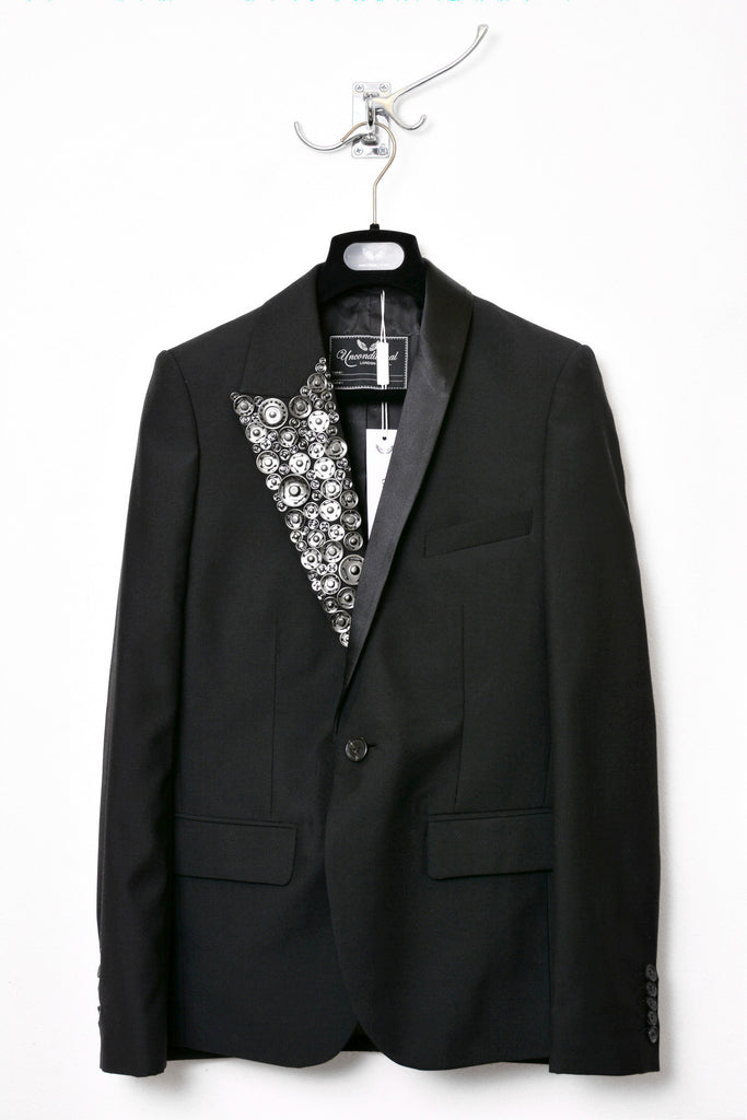 UNCONDITIONAL Asymmetric revered tuxedo jacket with one hand embellished metallic revere.