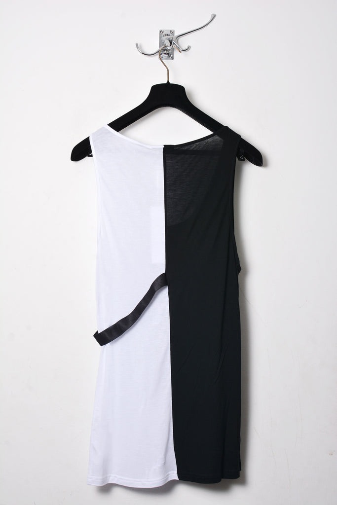 UNCONDITIONAL black and white rayon two tone split vest with elastic chest loop.