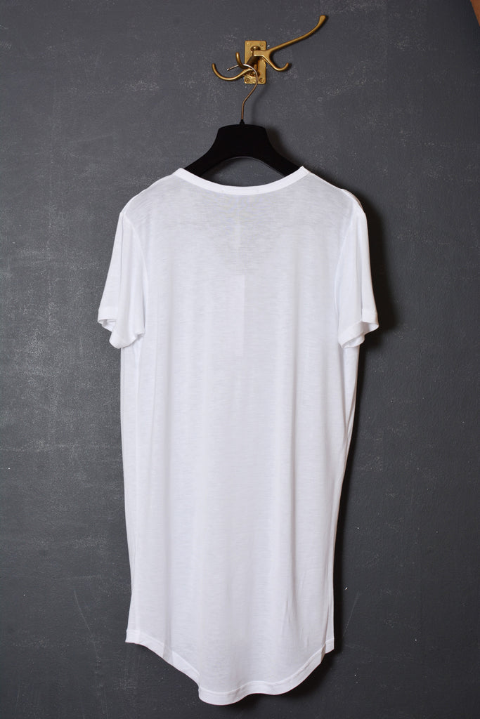 UNCONDITIONAL white V neck rayon front tail T shirt with a shoulder pleat and its back in cotton.