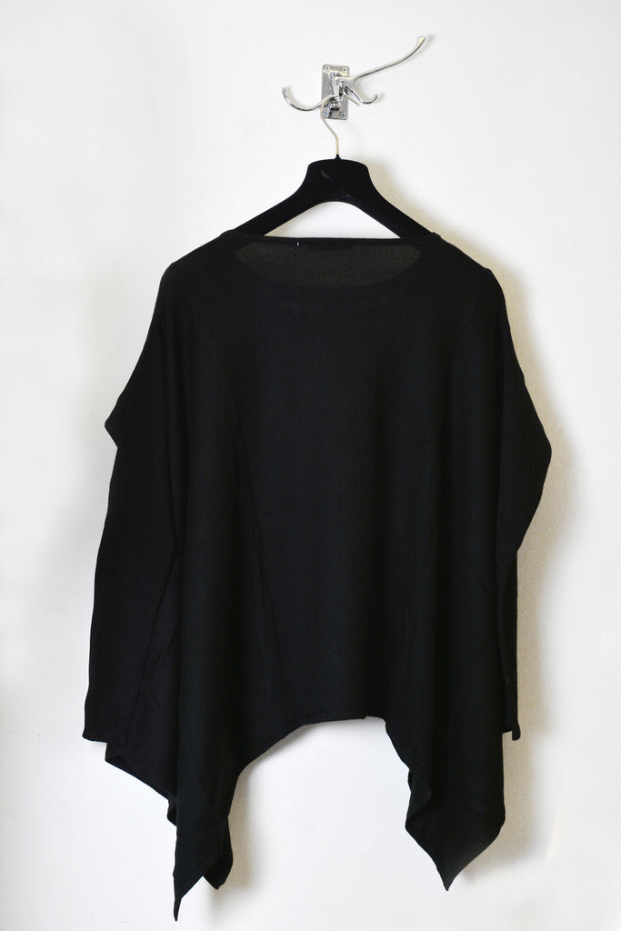 UNCONDITIONAL black merino wool disco poncho.