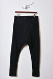 UNCONDITIONAL ladies black sweat shirting double zip trousers.