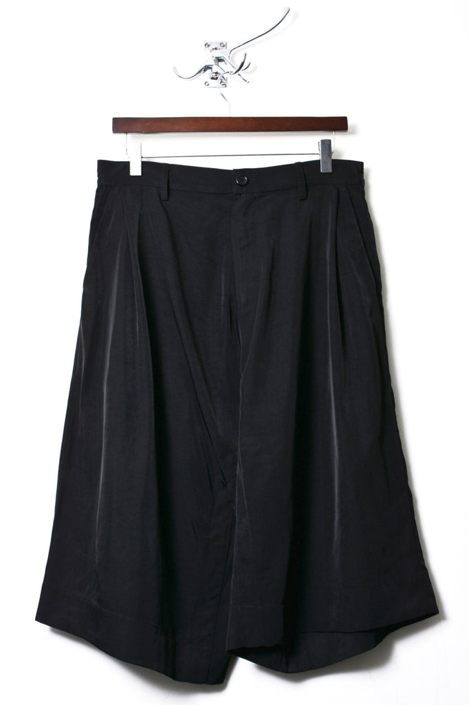 UNCONDITIONAL black memory twill long wrap shorts.