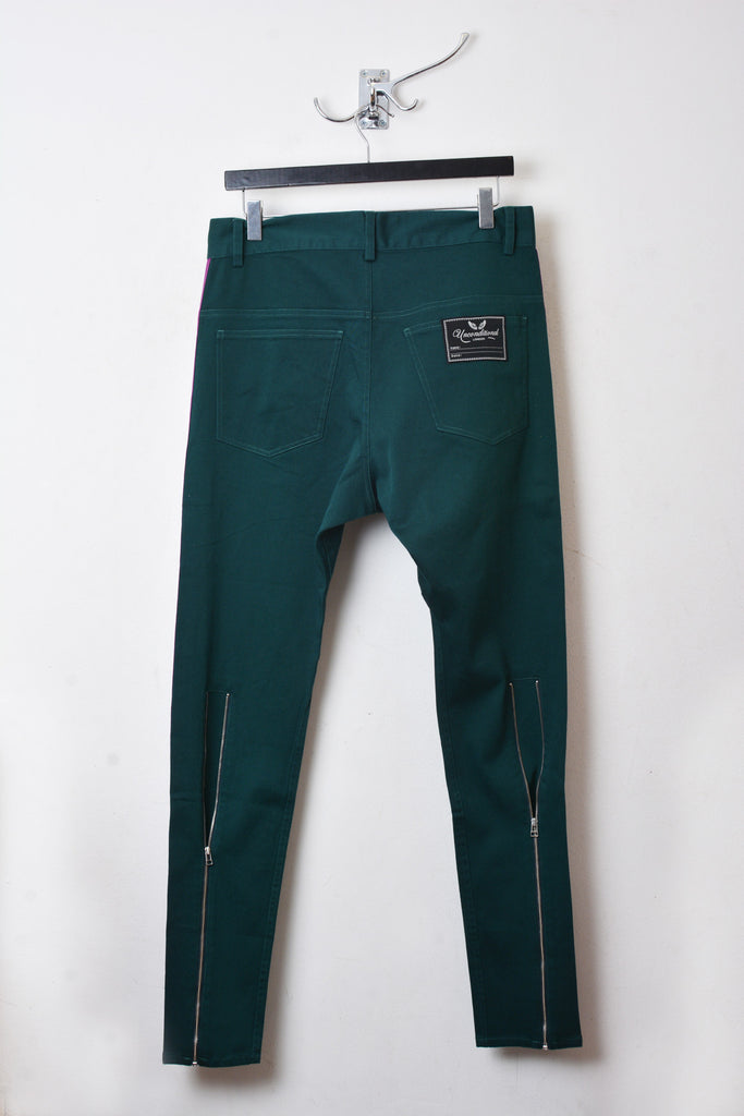 UNCONDITIONAL dark green  stretch denim drop crotch trousers with purple tuxedo side ribbon.