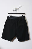 UNCONDITIONAL Black wool tailored shorts with contrast matt black foiled rib waistband