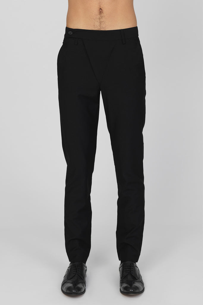 UNCONDITIONAL Signature Black wool asymmetric fly slim trousers.