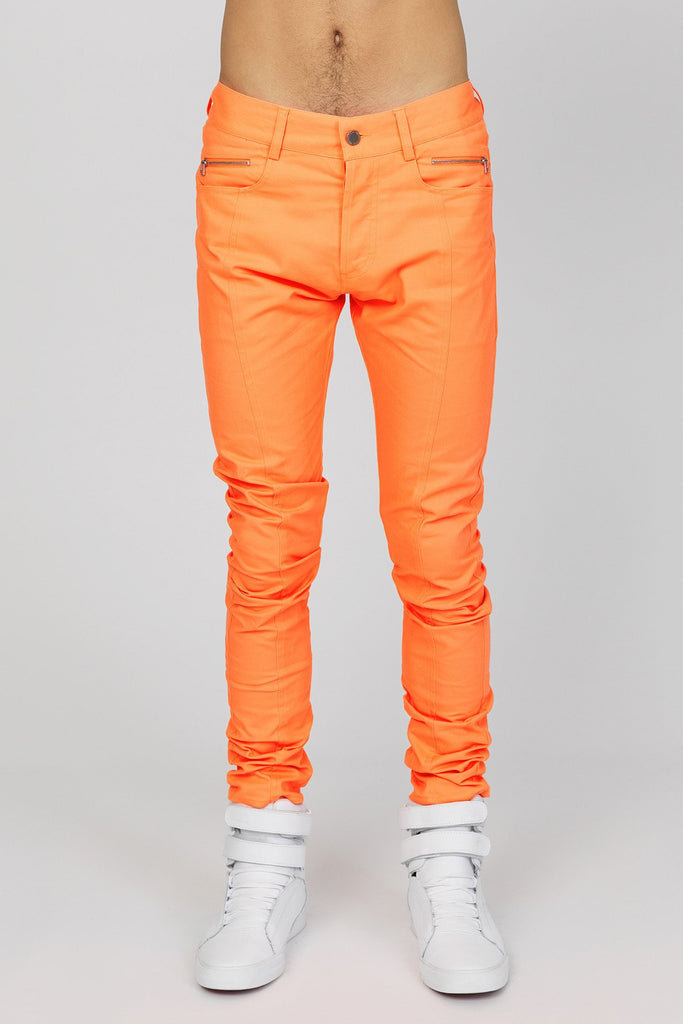 UNCONDITIONAL neon pink stretch drill slim fit jeans.