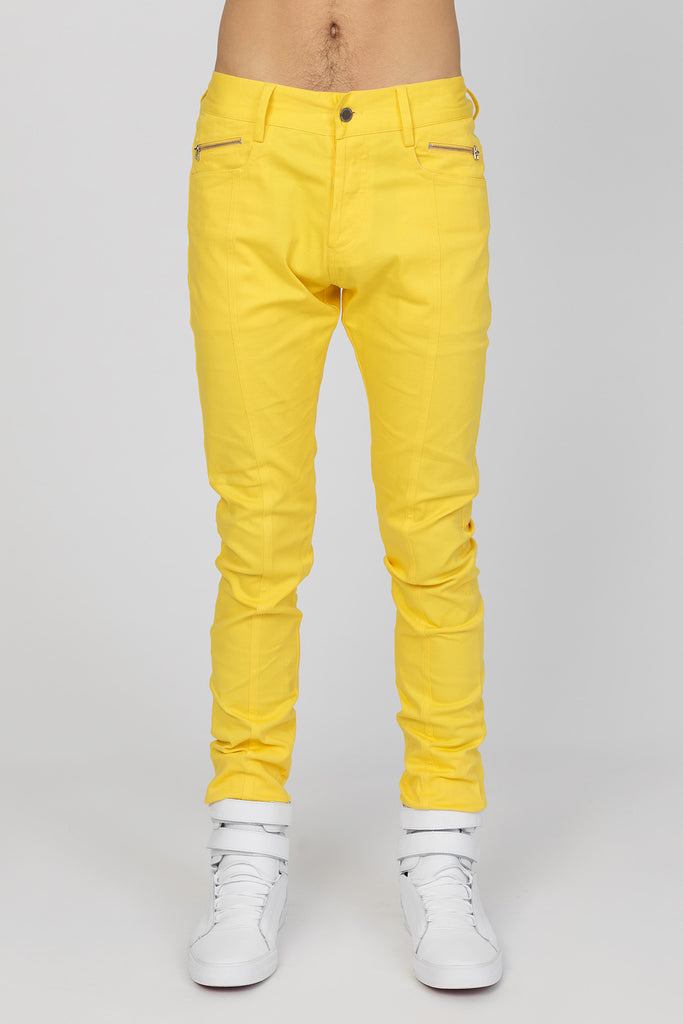 UNCONDITIONAL yellow stretch drill slim fit jeans.