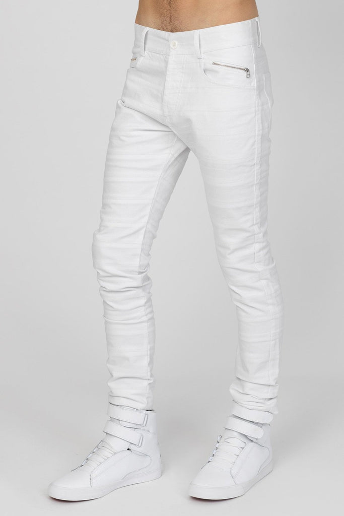 UNCONDITIONAL's SS18 White light stretch skinny jeans cut in striped panels