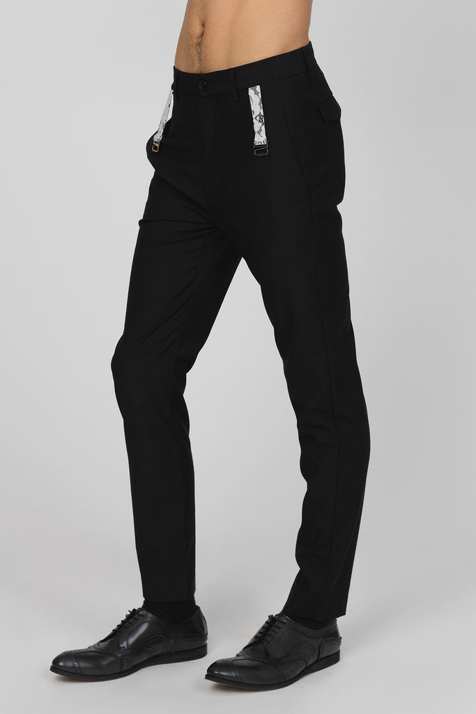 UNCONDITIONAL Black wool cigarette trousers with white lace garter detail.
