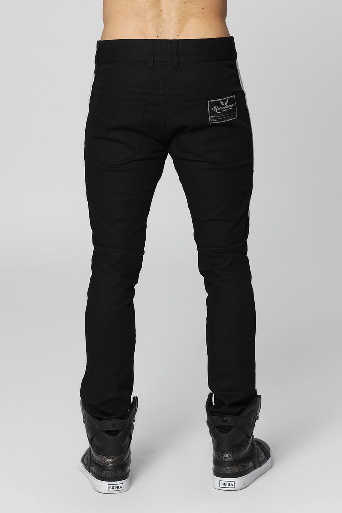 UNCONDITIONAL Black light stretch denim skinny jeans with white silk tuxedo stripe.