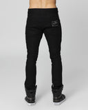 UNCONDITIONAL Black light stretch denim skinny jeans with black silk tuxedo stripe.