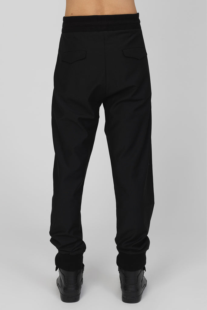 UNCONDITIONAL Black and white tailored trousers with contrast pocket detail.