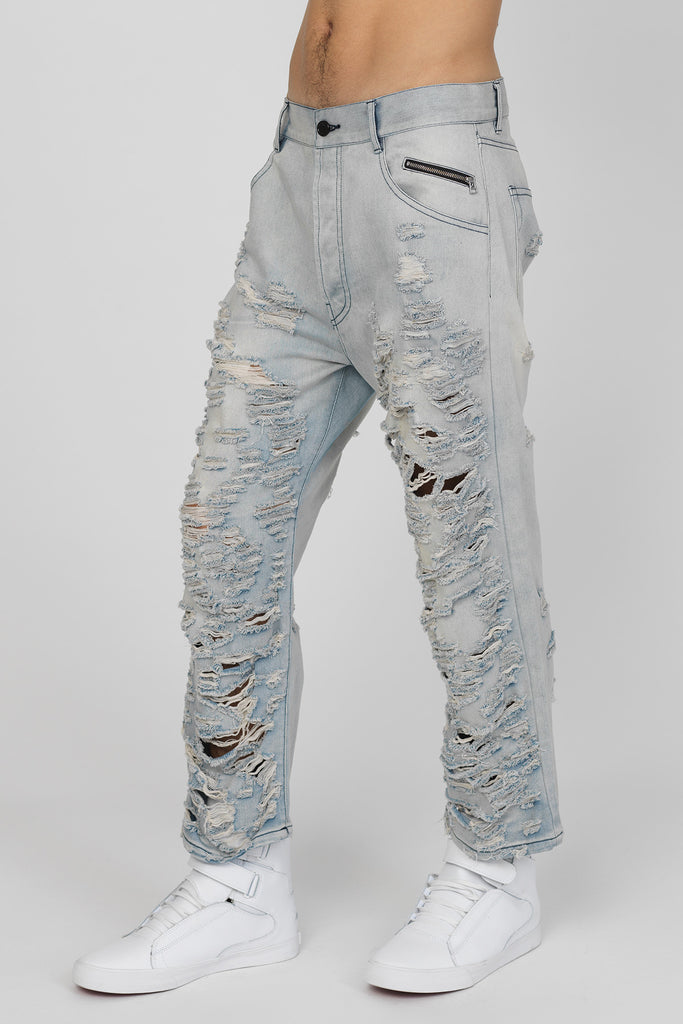 UNCONDITIONAL Cropped, hand aged and and hand shredded workwear jeans.