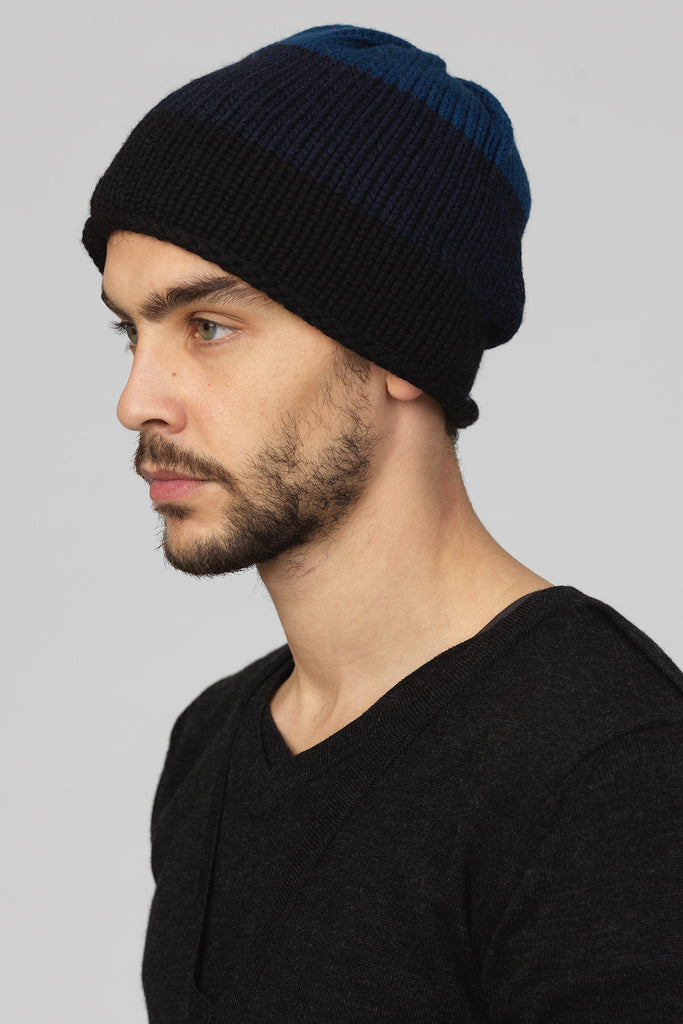 UNCONDITIONAL Black/blue gradient stripes merino signature hand knitted beanie.