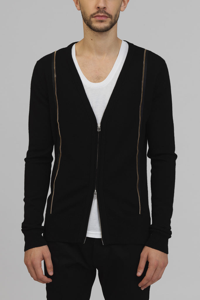 UNCONDITIONAL Black tail zip front cardigan with silver and gold appliqued zip detailing.