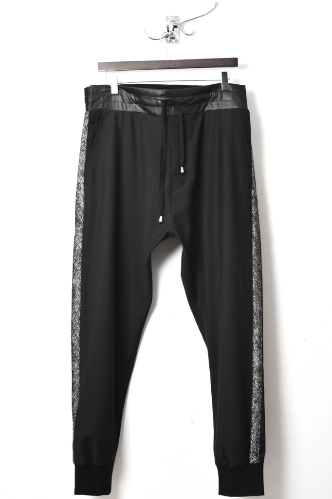 UNCONDITIONAL black tailored trouser with waistband and silver side ribbon.