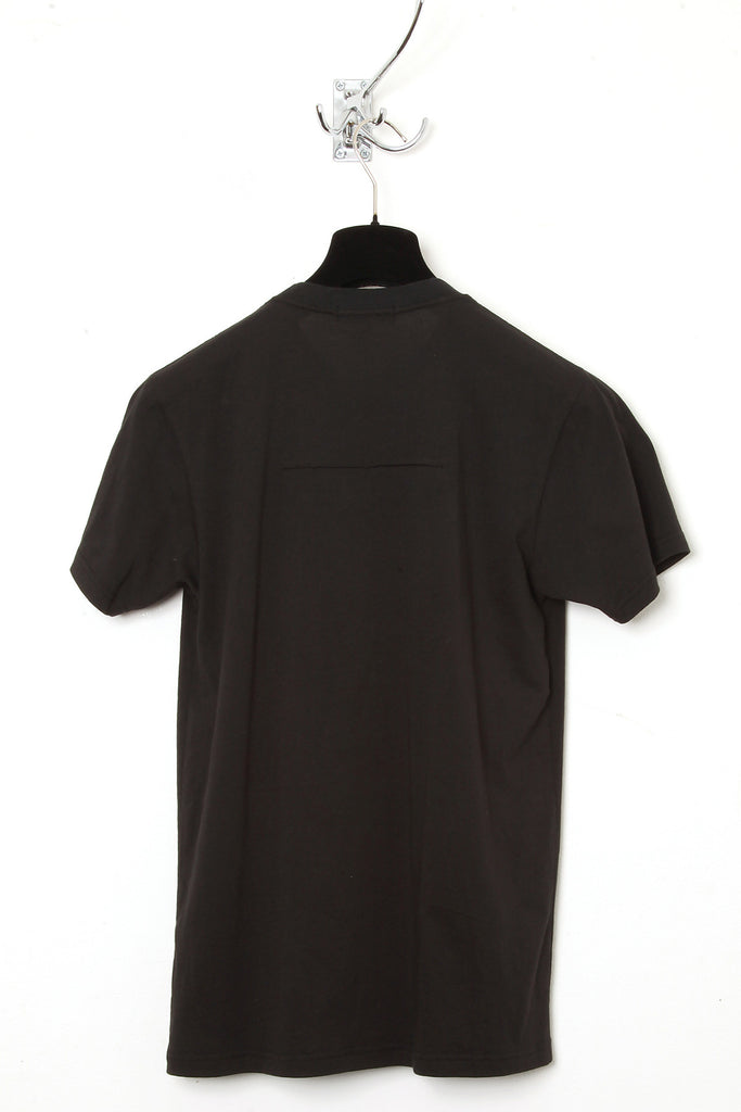 UNCONDITIONAL SS18 Black bib T-shirt with an applied silver metal poppers.