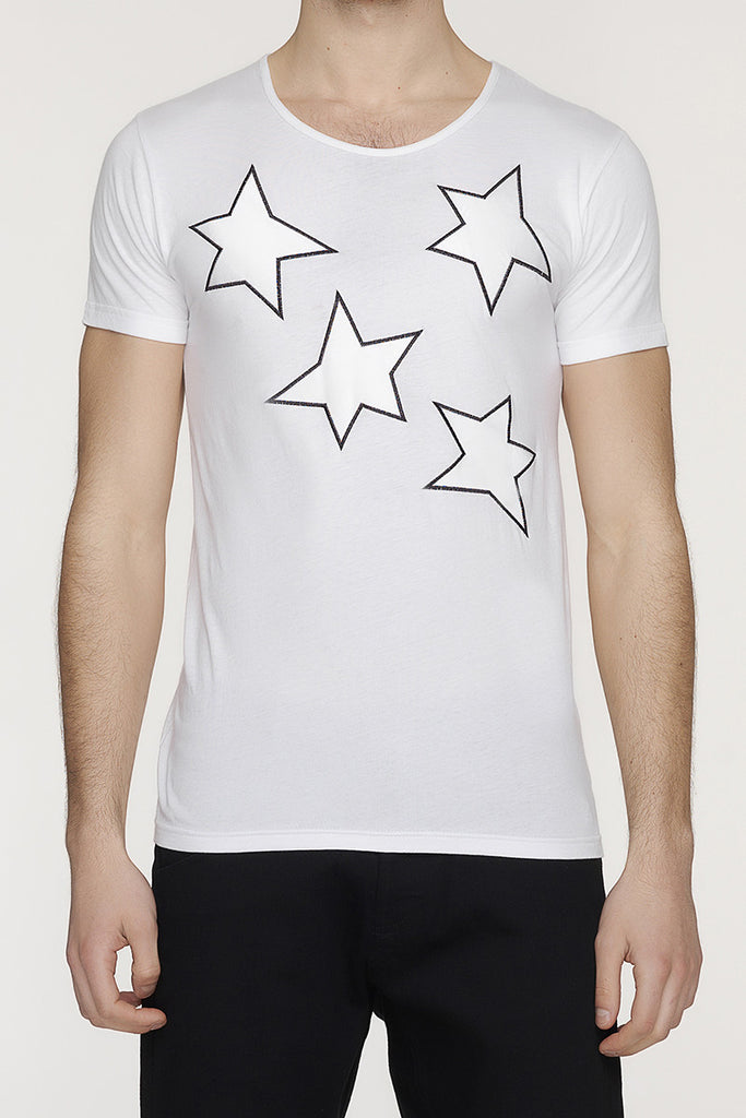 UNCONDITIONAL white and white t-shirt with silk stars applied.