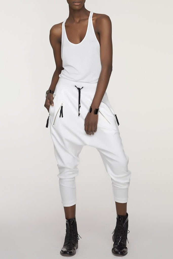 UNCONDITIONAL's SS16 white drop crotch full length trousers with double zip pockets.