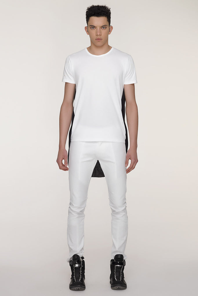UNCONDITIONAL White and Black double tail tee with pleated back.