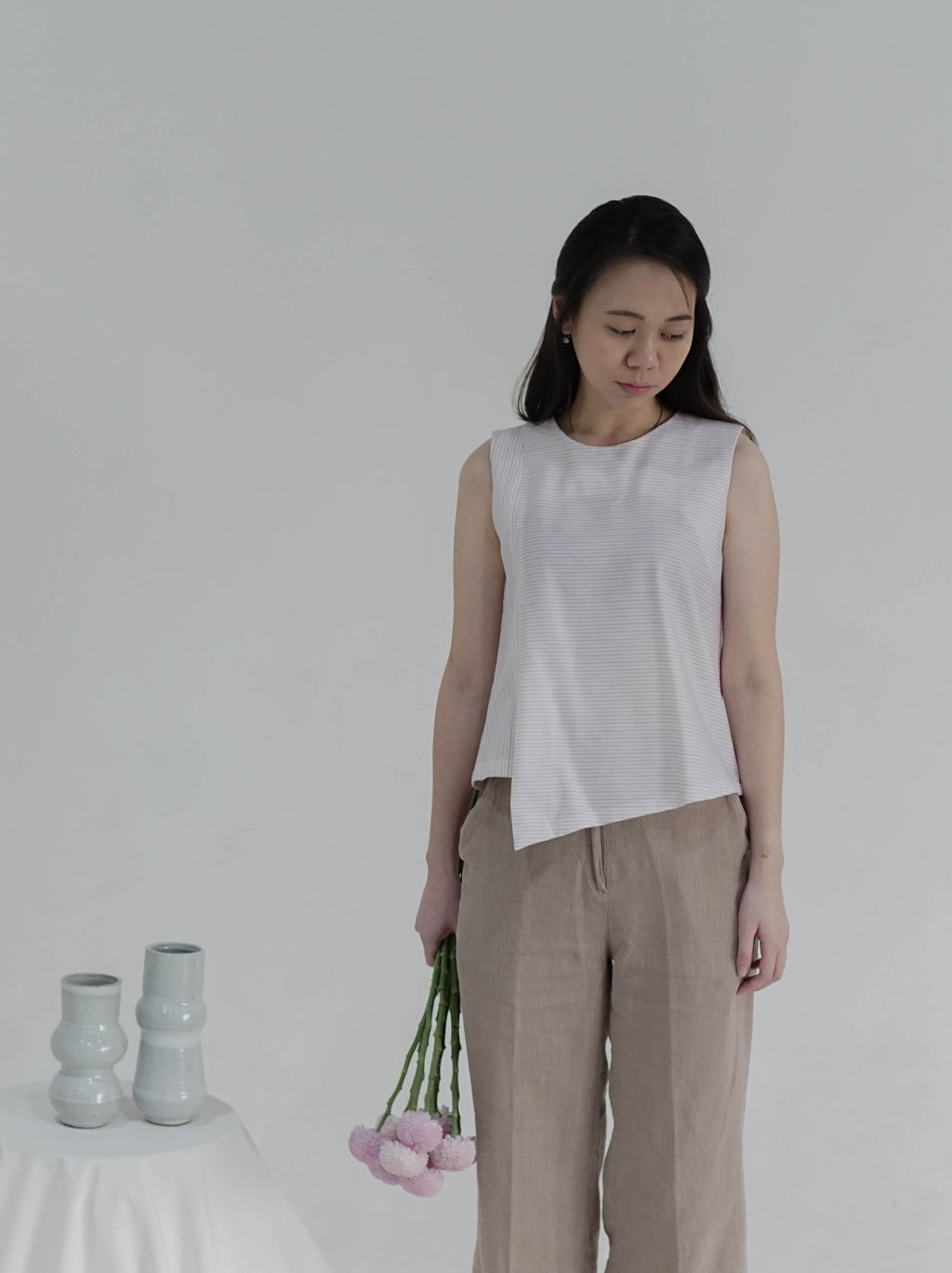 Sleeveless Top with Triangular Hem