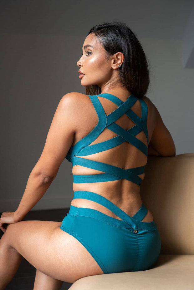 Serena Lunalae top. Criss cross back in teal