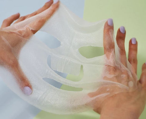 Sheet Mask Stretched Out In Hands