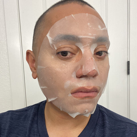 Anthony wearing a L'Herboflore sheet mask