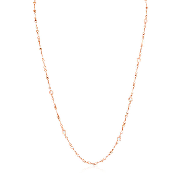 18K Rose Gold Necklace With A Corkscrew Design and Seven Round Diamond Stations