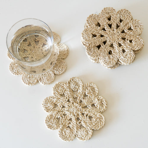 Our collection of eco-chic jute drink coasters look glorious on their own or with our selection of placemats. neutral flower coaster. natural flower coaster. floral coaster. natural jute coaster. Flower jute coaster.