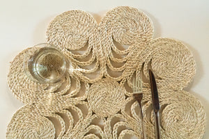 Our flower placemats are handwoven from jute to add that understated chic beach vibe to your dinner sets.  Jute placemat. Table Mat. Woven placemat. Natural flower placemat.  Neutral flower placemat.