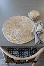 Our round placemats are handwoven from jute to add that understated chic beach vibe to your dinner sets.  Jute placemat. Table Mat. Natural placemat. Round neutral placemat.