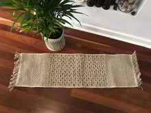 Our intricately handmade jute table runners can dress up any table top. macrame table runner. Natural macrame table runner. Neutral table runner.