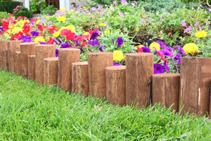 Wooden Full Log Staggered Lawn Edging 3 ft x 7 in (6 Pack) RC47B-6C in use