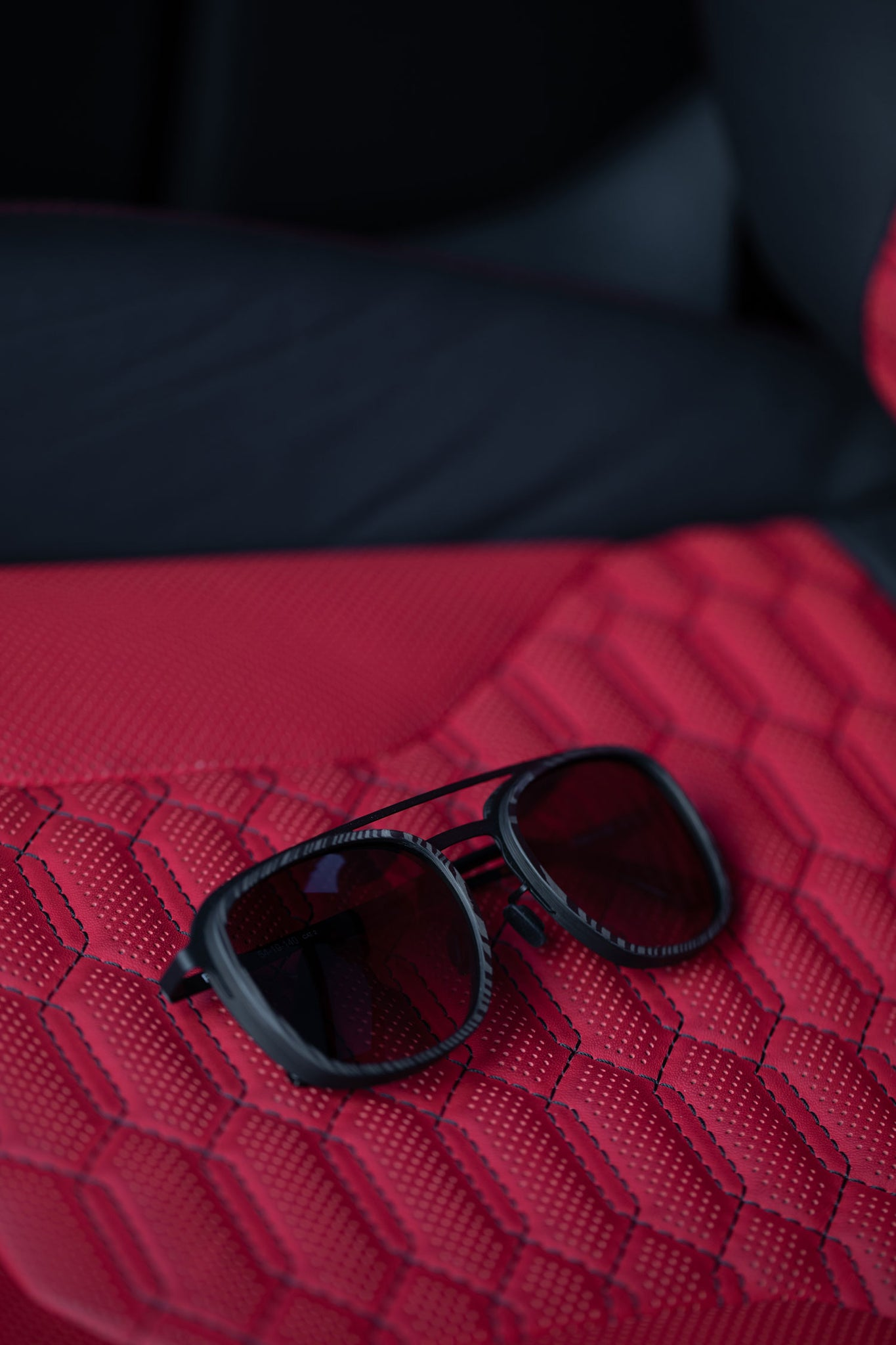 Roveri Eyewear RV018B aviators carbon fiber sunglasses on Lamborghini Urus leather seat.