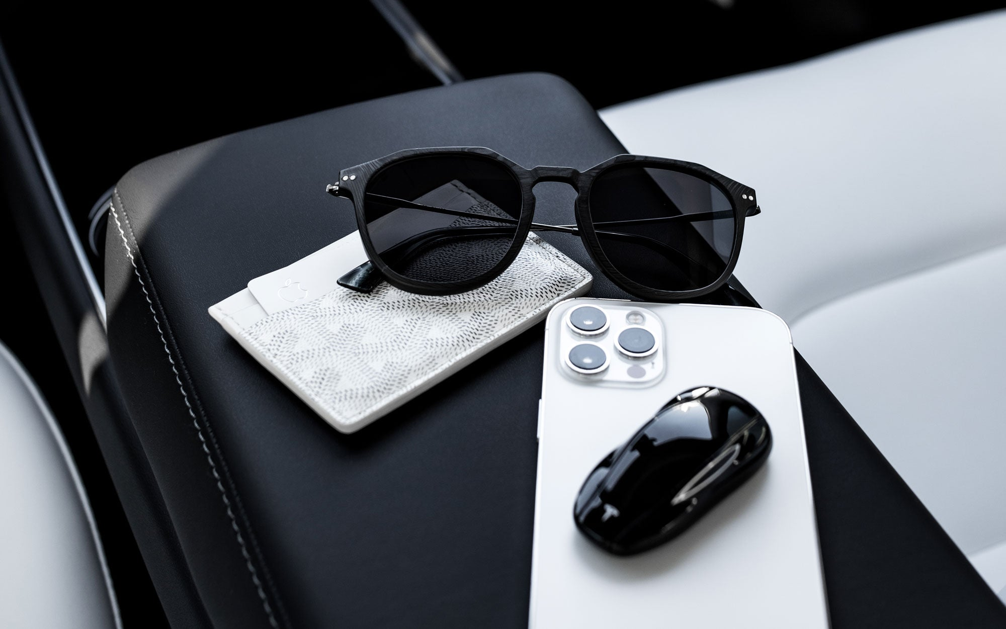 Roveri Eyewear all new CLM7 carbon-titanium sunglasses for men with Goyard card holder saint Sulpice and iPhone 12 max in Los Angeles.