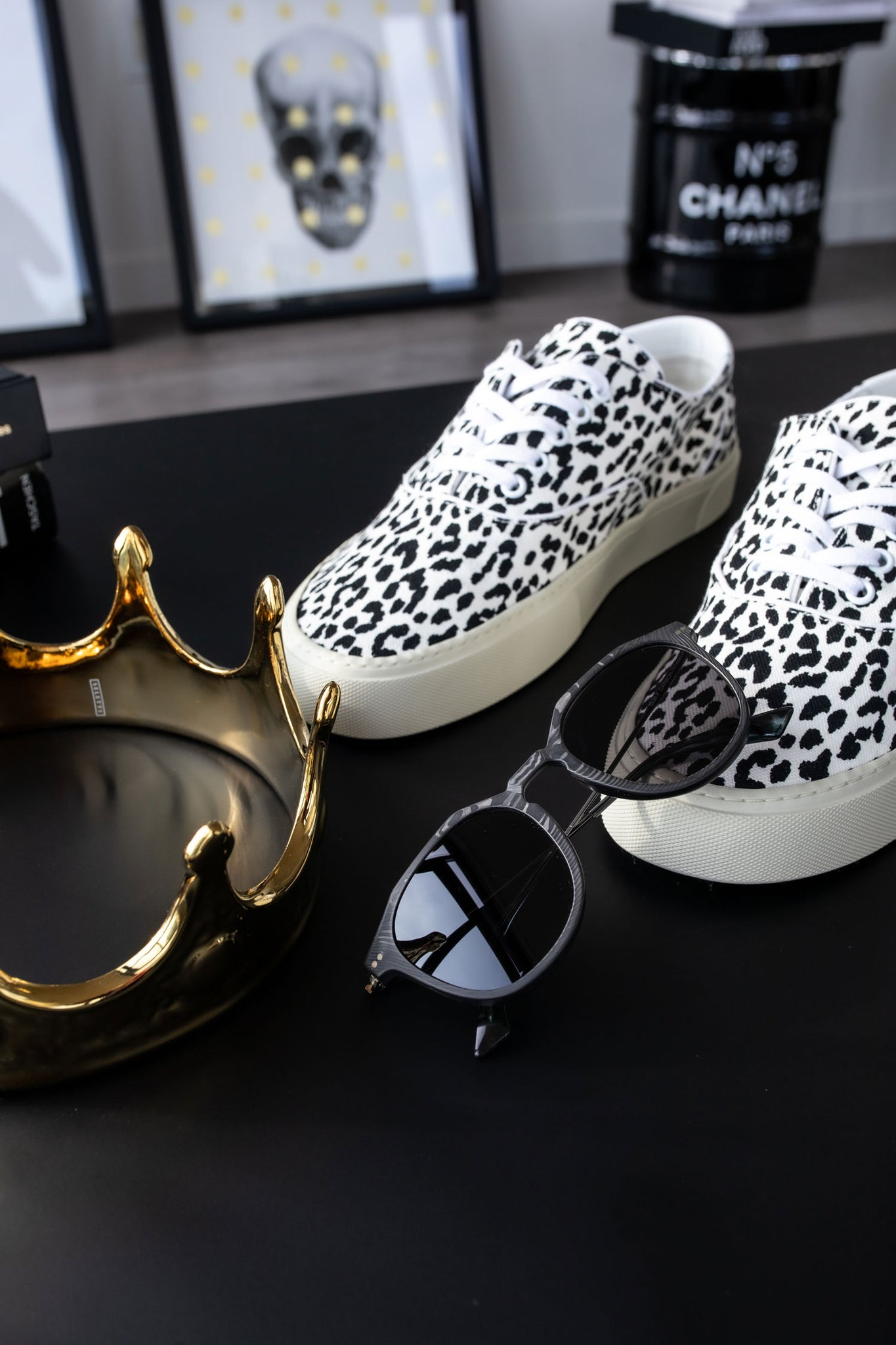 Saint Laurent Venice low top sneakers on table in DTLA with Roveri Eyewear CLM7 black on black by paid2shoot.