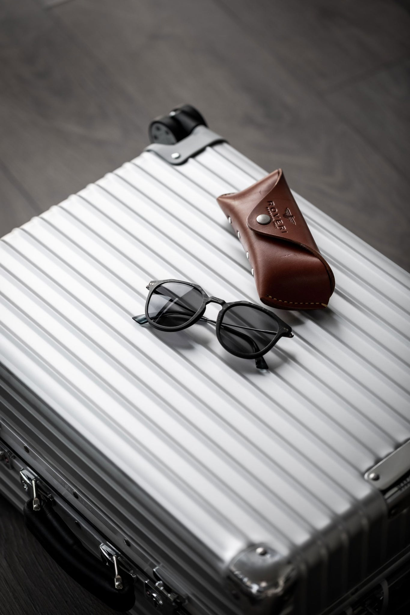 Roveri Eyewear clm7 black on black x Rimowa classic cabin suitcase paired with premium handmade leather case.