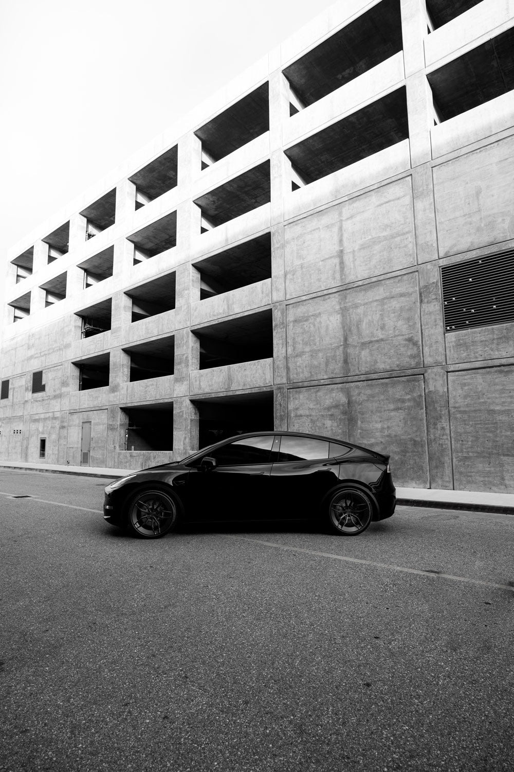 Tesla Model Y photoshoot in Playa Vista with paid2shoot and Roveri Eyewear new CLM7 carbon-titanium designer sunglasses, made in Italy.