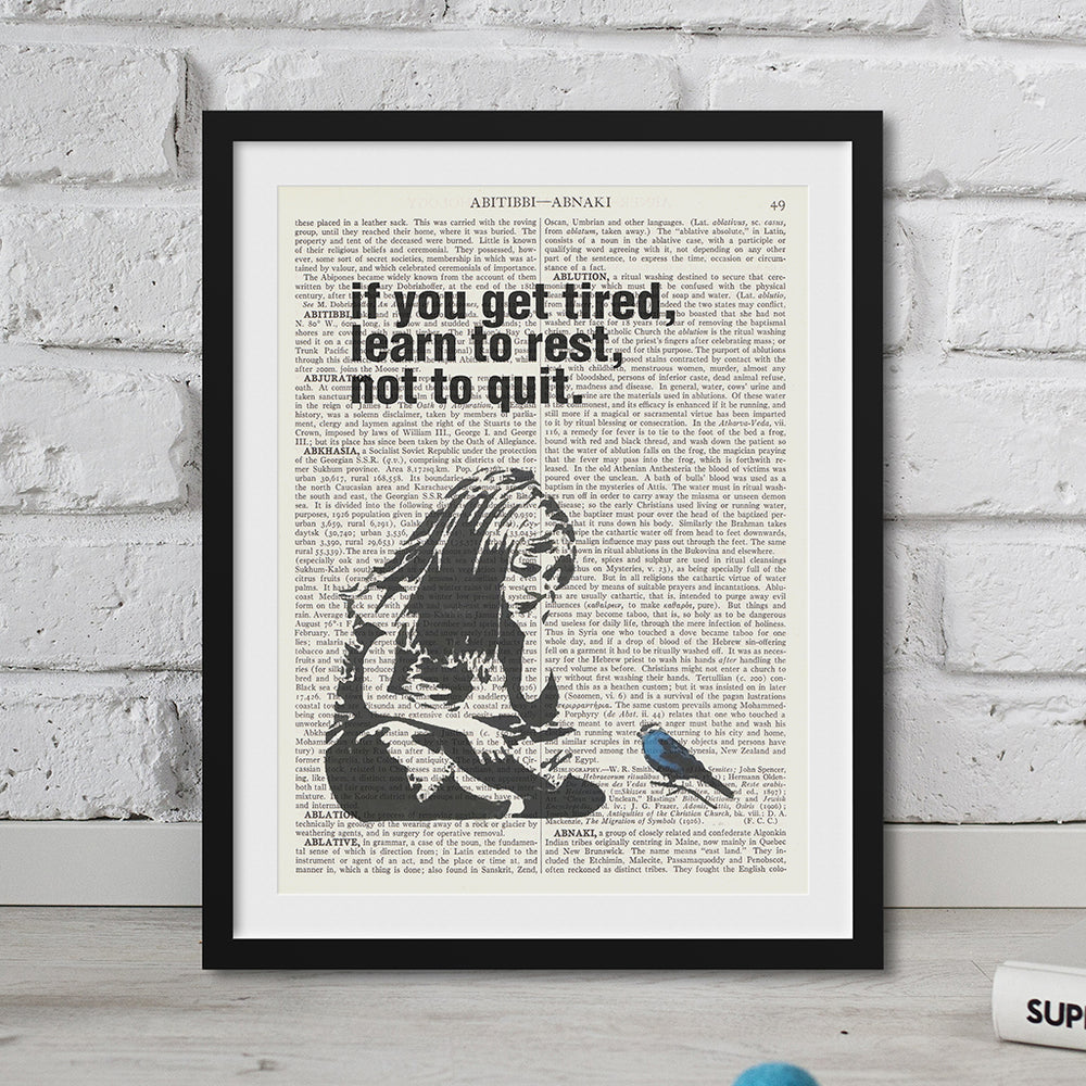 If you get tired, learn to rest, not to quit quote printed onto a vintage dictionary page.