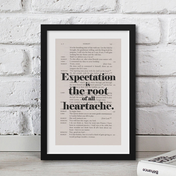 Expectation is the root of all heartache printed onto a book page art
