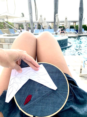 embroidering by the pool