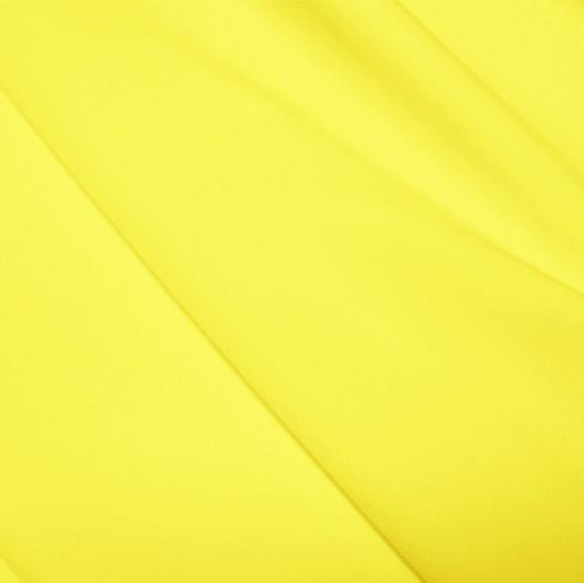 A flat sample of polyester lycra fabric in the color citron.
