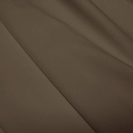 A flat sample of polyester lycra fabric in the color dust.