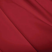 A flat sample of polyester lycra fabric in the color EBI Burgundy.